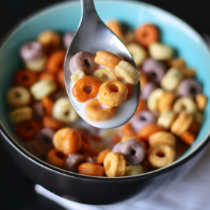 health foods you should avoid. A spoon scooping up cereal from a bowl